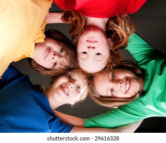 Group of little students with different ages in a happy mood