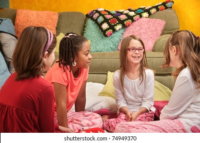 Group of little young girls chat at a sleepover