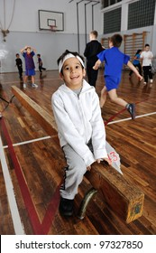 Group of lovely kids doing gymnastics in gym hall