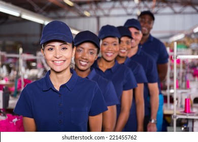 group of machinists line up in clothing factory