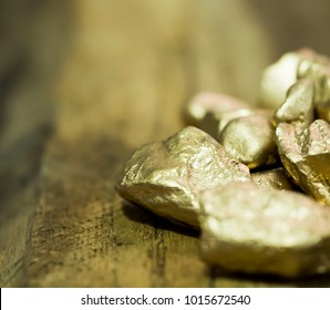 group of macro Gold ore in the boulder , precious stone on wooden background
