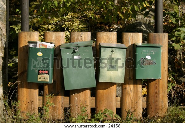 A group of mailboxes sitting in a row.