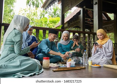 group of malay family breaking the fast together