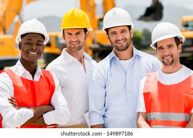 Group of male construction workers at a building site