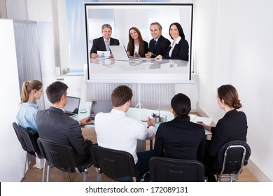 Group Of Male And Female Businesspeople At Video Conference