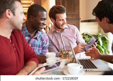 Group Of Male Friends Meeting In Cafe Restaurant