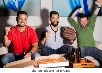 Group of male friends watching a baseball and celebrating a home run from their favorite team