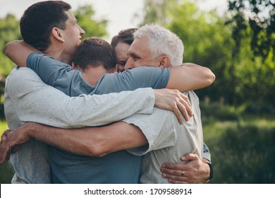a group of male hugging. Portrait of happy people. Joy after a long separation. The concept of relationships in the family, friends