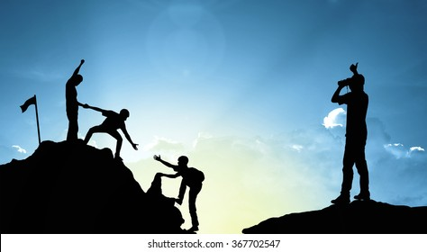 Group of man on peak mountain climbing helping on sunset background  teamwork  success winner business concept