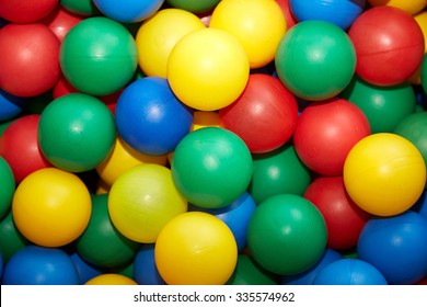 Group of many multicolored plastic balls. Close-up view