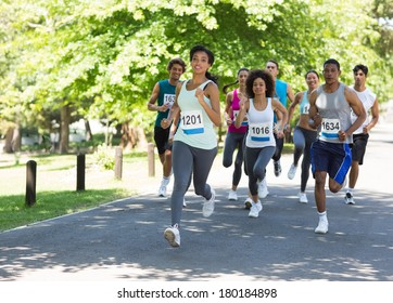 Group of marathon athletes running on street