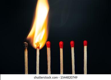 Group match burning on a black background detail art
