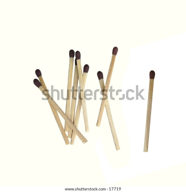 A group of matched isolated on white with clipping path.  One match is unused and singled out from the rest.