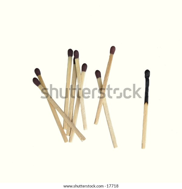A group of matches with one singled out burned match, isolated on white with clipping path.