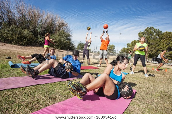 Group of mature adults working out in fitness class