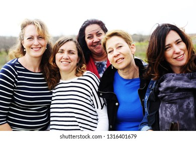 Group of mature beautiful ladies enjoying on a nice day outside