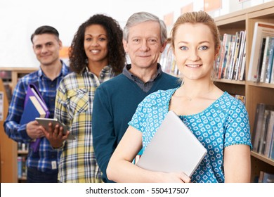 Group Of Mature Students Studying In Library