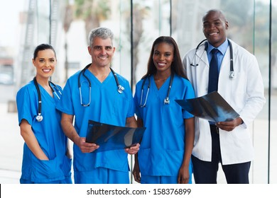 group of medical doctors in office with patient's x-ray