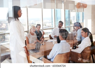 Group Of Medical Staff Meeting Around Table In Hospital