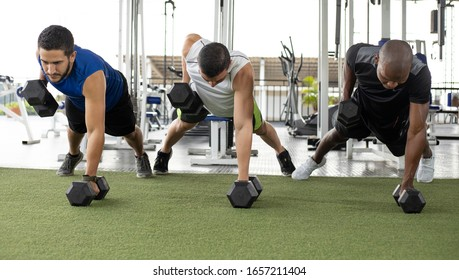 group of men doing push up in the gym
