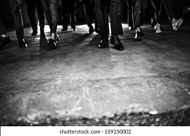 a group of men or gangsters in suit walking in dramatic lighting