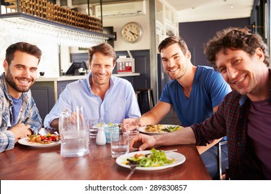 A group of men having lunch in a restaurant