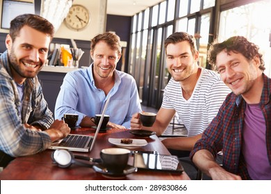 Group of men meeting at a coffee shop, portrait