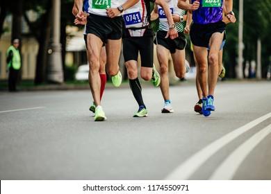 group men runners city race run on asphalt road