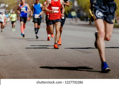 group men runners running on street of city marathon