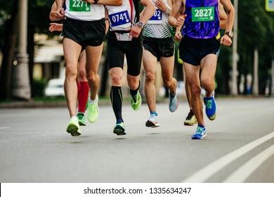 group men runners running street in marathon race