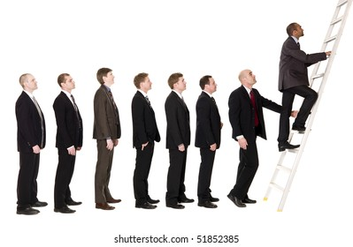 Group of men standing in line to climb a ladder