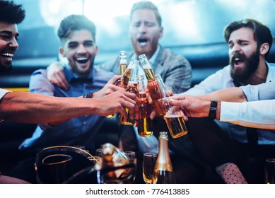 Group of men toasting with beer
