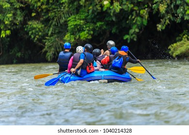 A group of men and women are rafting on the river, extreme and fun sport