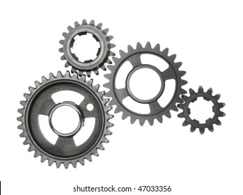 A group of metal gears linked together, isolated on a white background.