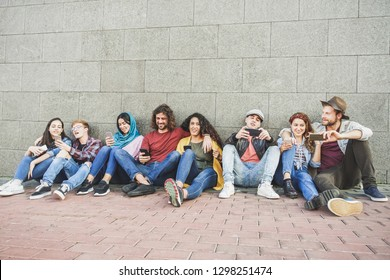 Group of millennial friends using smart mobile phones - People addiction to new technology trends - Concept of youth, z generation, social network and friendship - Main focus on center faces