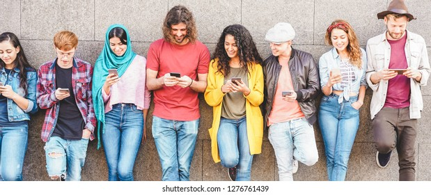 Group of millennial friends watching social story on smart mobile phones - People addiction to new technology trend - Concept of youth, z generation, social and friendship - Main focus on center guys
