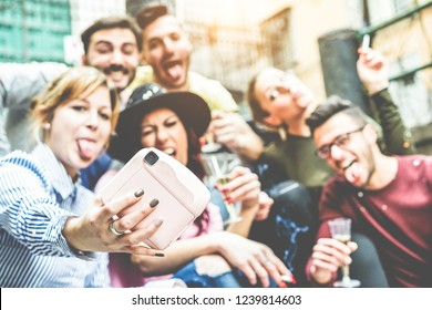 Group of millennials people taking selfie with instant camera at party outdoor - Young friends having fun drinking champagne and celebrating together - Tech trends concept - Focus on photocamera hand