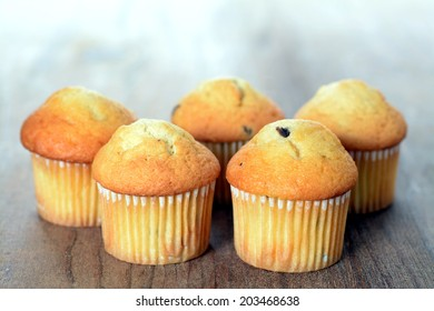 a group mini muffins on rustic table