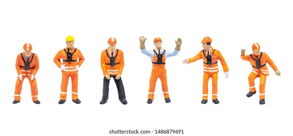 Group of Miniature figurine character as railway shunter standing and posing in posture isolated on white background.