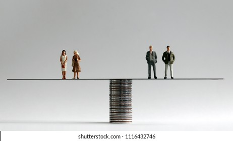 A group of miniature men and women standing on either side of a pile of coins.