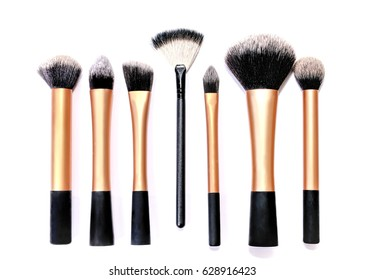 Group of mixed cosmetic brshes in random order, isolated on a white background