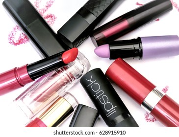 Group of mixed cosmetics in random order, isolated on a white background