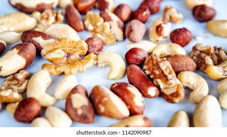 group of mixed nuts on a white plate
