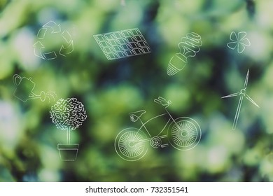 group of mixed renewable energy and sustainable development-related objects over green tree bokeh background