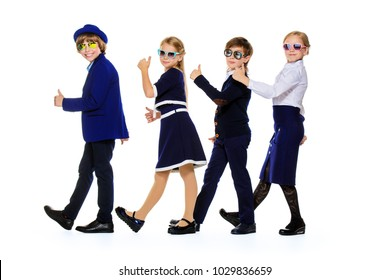 Group of modern children posing in school uniform and sunglasses. School fashion. Isolated over white background. Full length portrait.
