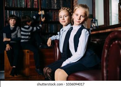 Group of modern children posing in school uniform in luxurious apartments. School fashion.