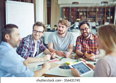 Group of modern employees discussing their working ideas