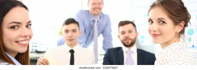 Group of modern millennial businesspeople in office debate on financial issue hold in arms documents portrait. Success assessment human resources data analysis person candid concept