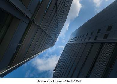 A group of modern skyscrapers in the city with beautiful sky and clouds.