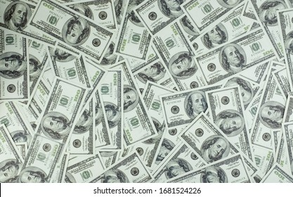 Group of money stack of 100 US dollars banknotes a lot of the background texture, top view